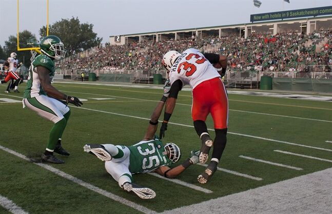 B.C. Lions running back Andrew Harris runs in a touchdown after he breaks a tackle from Saskatchewan Roughriders linebacker Weldon Brown during the first quarter of CFL football action in Regina, Sask., Saturday, July 12, 2014. THE CANADIAN PRESS/Liam Richards
