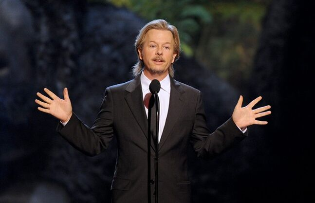FILE - In this Saturday, June 8, 2013, file photo, David Spade presents the hot and funny award at Spike TV's Guys Choice Awards at Sony Pictures Studios, in Culver City, Calif. Dey Street Books announced Monday, June 2, 2014, that actor and comedian Spade is working on a memoir scheduled to come out in fall 2015. According to Dey Street, an imprint of HarperCollins Publishers, Spade will write about everything from his childhood in Arizona to his friendship with the late comedian Chris Farley. (Photo by Frank Micelotta/Invision/AP, File)