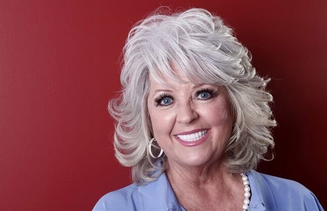 FILE - In this Tuesday, Jan. 17, 2012 photo, Paula Deen poses for a portrait in New York. Deen's comeback trail is leading her to the Smoky Mountains of east Tennessee. The Savannah, Ga.-based celebrity cook announced Wednesday, Feb. 26, 2014, she's opening a new restaurant, Paula Deen's Kitchen, in Pigeon Forge, Tenn. (AP Photo/Carlo Allegri, File)