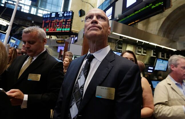 Former New York Rangers hockey player and general manager Mark Messier, center, looks over the New York Stock Exchange trading floor, Friday, June 20, 2014 before opening bell ceremonies to mark the first day of trading of Performance Sports Group, Friday, June 20, 2014. (AP Photo/Richard Drew)