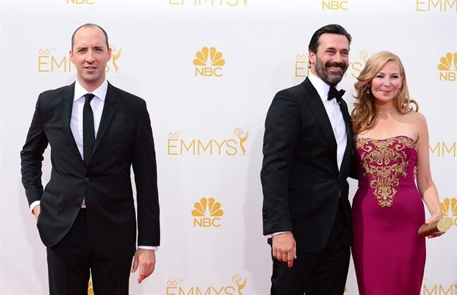 Tony Hale, from left, Jon Hamm and Jennifer Westfeldt arrive at the 66th Annual Primetime Emmy Awards at the Nokia Theatre L.A. Live on Monday, Aug. 25, 2014, in Los Angeles. (Photo by Jordan Strauss/Invision/AP)