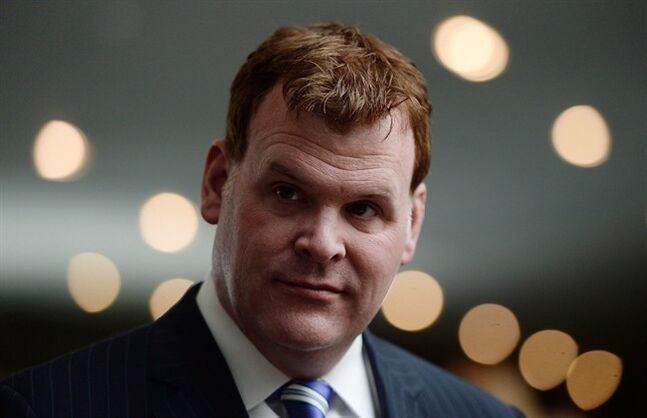 Minister of Foreign Affairs John Baird takes part in an event at the National War Museum in Ottawa on May 12, 2014. Canada's commissioner of official languages has launched an investigation into John Baird's Twitter account to determine if the foreign affairs minister is running afoul of federal laws around bilingual communication. THE CANADIAN PRESS/Sean Kilpatrick