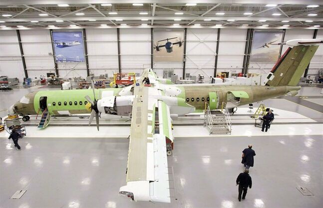 Bombardier Aerospace employees assemble a Q400 airliner in Toronto, March 25, 2011. THE CANADIAN PRESS/Darren Calabrese