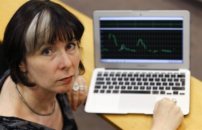 Jane Setter, Professor of Phonetics at University of Reading, poses for a photograph in London, Wednesday, Aug. 20, 2014, as she sets up her voice analyst program to analyses the voice the man who speaks on a video before seemingly killing journalist James Foley. Setter said the man was likely educated in the U.K. or in a U.K.-based system. (AP Photo/Kirsty Wigglesworth) EDS NOTE: SCREEN DOES NOT SHOW VOICE OF MAN IN JAMES FOLEY VIDEO