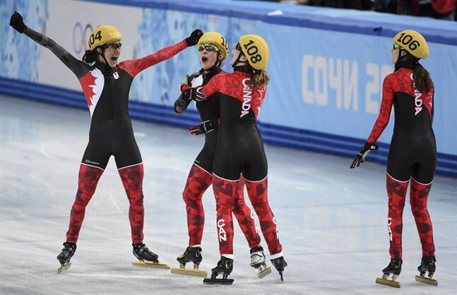 Canada's Marie-Eve Drolet, Valerie Maltais and Marianne St-Gelais, and Jessica Hewitt, left to right, react as the results are announced winning the silver medal in the women's 3,000 metre relay final at the Sochi Winter Olympics Tuesday, February 18, 2014 in Sochi. THE CANADIAN PRESS/Paul Chiasson