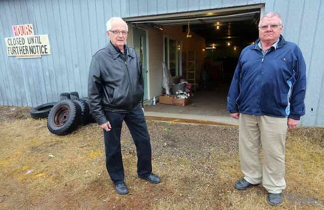 Vern Gilbertson and Arnold Grambo are upset to see items from the former Habitat for Humanity ReStore being taken to the landfill.
