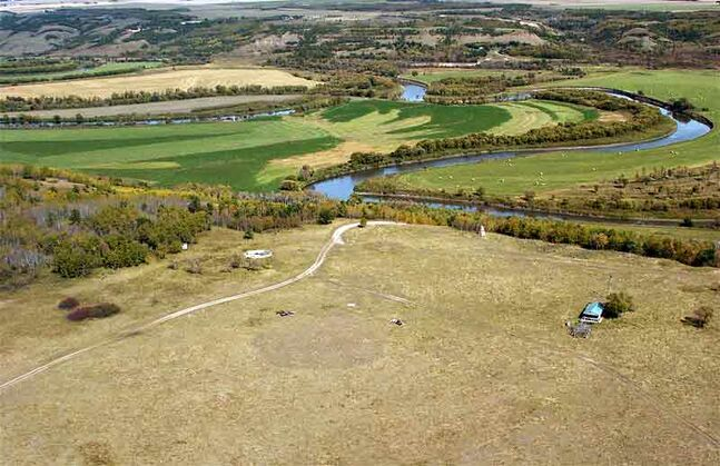 An aerial view of the historic Fort Ellice site, with the Assiniboine River in the background.