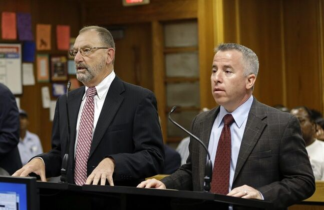 Assistant state attorney David Gilbert, left, and defense attorney Mark Shapiro, right, appear in court to request a postponement of the hearing to determine whether pop star Justin Bieber will be tried on charges of driving under the influence and resisting arrest, in Miami, Tuesday, Aug. 5, 2014. Bieber was arrested Jan. 23 in Miami Beach after what police described as an illegal street race between Bieber and a friend. Miami-Dade County Judge William Altfield postponed the hearing until Aug. 13. (AP Photo Alan Diaz, Pool)