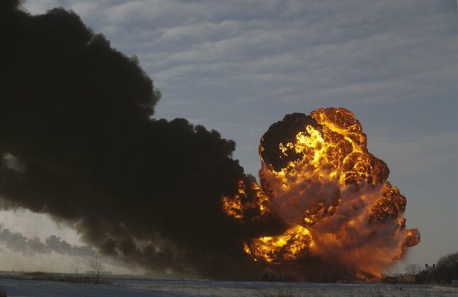FILE - In this Dec. 30, 2013 file photo, a fireball goes up at the site of an oil train derailment in Casselton, N.D. Rail cars being used to ship crude oil from North Dakota's Bakken region are an