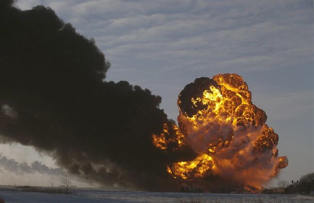 FILE - In this Dec. 30, 2013 file photo, a fireball goes up at the site of an oil train derailment in Casselton, N.D. Warning that a