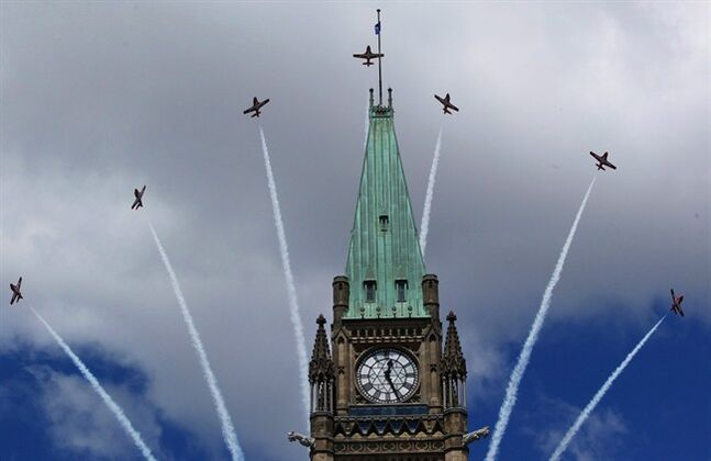 Canadian Snowbirds fly over top of the Peace Tower during Canada Day celebrations in Ottawa on July 1, 2011. THE CANADIAN PRESS/Fred Chartrand