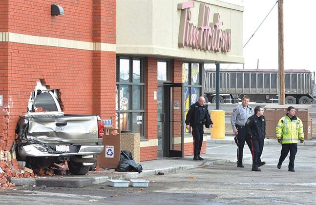 Officials survey the damage at the Taber Tim Hortons on March 7, 2012 in Taber, Alta. THE CANADIAN PRESS/Tabor Times, Greg Price