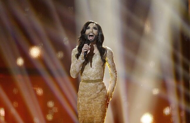 Singer Conchita Wurst representing Austria performs the song 'Rise Like a Phoenix' during the final of the Eurovision Song Contest in the B&W Halls in Copenhagen, Denmark, Saturday, May 10, 2014.(AP Photo/Frank Augstein)