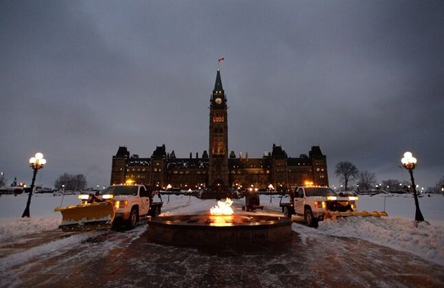 Crews work on Parliament Hill in Ottawa in a November 27, 2013 photo. THE CANADIAN PRESS/Sean Kilpatrick