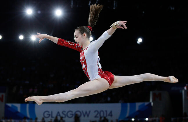 Brandon's Isabela Onyshko leaps during her beam routine as she takes part in the women's team final and individual qualification gymnastic competition at the Commonwealth Games in Glasgow, Scotland, on Tuesday. Canada finished fourth in the women's team final with Onyshko seventh on the beam and 10th in the all-around.