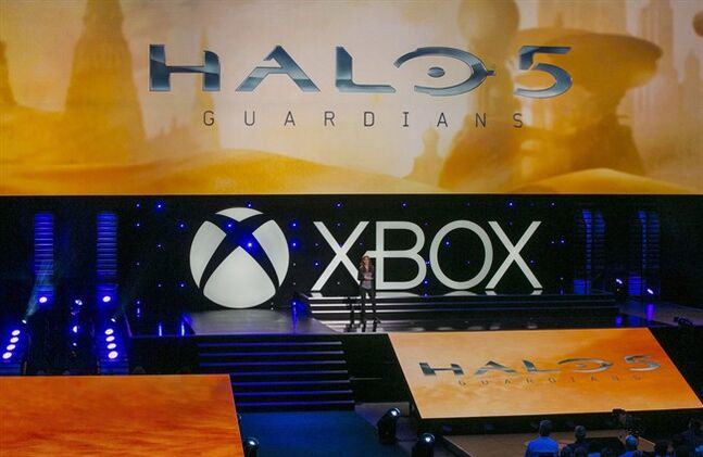 Bonnie Ross, General Manager of 343 Industries, Microsoft Games Studios, presents Halo 5: Guardians, an upcoming title for the Xbox One, during a presentation ahead of the Electronic Entertainment Expo at the University of Southern California's Galen Center on Monday, June 9, 2014 in Los Angeles. With the launch of the Xbox One, PlayStation 4 and Wii U in the video game industry's rearview mirror, the spotlight at E3 is expected to shift back to games. (AP Photo/Damian Dovarganes)