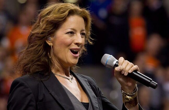 Canadian singer Sarah McLachlan sings the national anthem at B.C. Place stadium in Vancouver, B.C., on September 30, 2011. When she began assembling new songs for