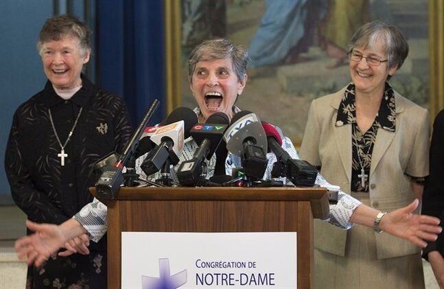 From left, Sisters Anne Leonard, Josephine Badali and Arlita Matte, all members of the Congretation Notre-Dame, express their joy as they attend a news conference in Montreal, Monday, June 2, 2014, where they spoke about the release of Sister Gilberte Bussiere, who was abducted along with two Italian priests in Cameroon. THE CANADIAN PRESS/Graham Hughes