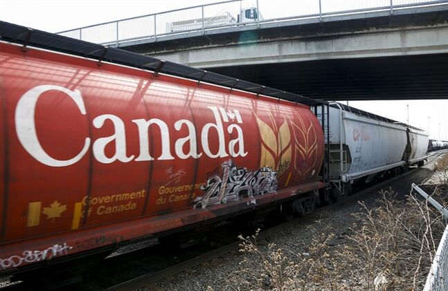 A Canadian Pacific Rail train hauling grain passes through Calgary, Thursday, May 1, 2014.THE CANADIAN PRESS/Jeff McIntosh