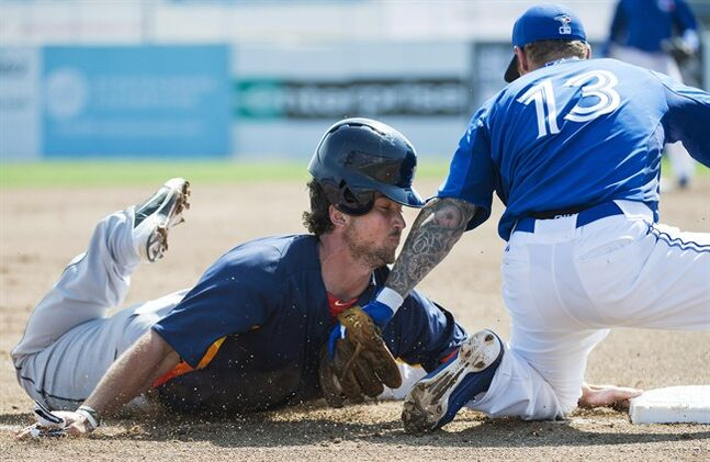 Toronto Blue Jays third baseman Brett Lawrie, right, tags out Houston Astros first baseman Brett Wallace, left, at third base during third inning MLB Grapefruit League baseball action Dunedin, Fla., on Wednesday, Feb. 27, 2013. THE CANADIAN PRESS/Nathan Denette