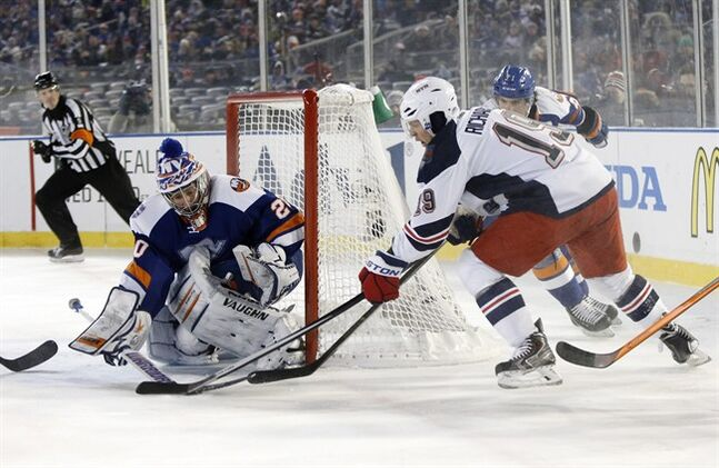 New York Islanders goalie Evgeni Nabokov (20) blocks a shot by New York Rangers center Brad Richards (19) in the second period of an outdoor NHL hockey game at Yankee Stadium in New York, Wednesday, Jan. 29, 2014. (AP Photo/Kathy Willens)