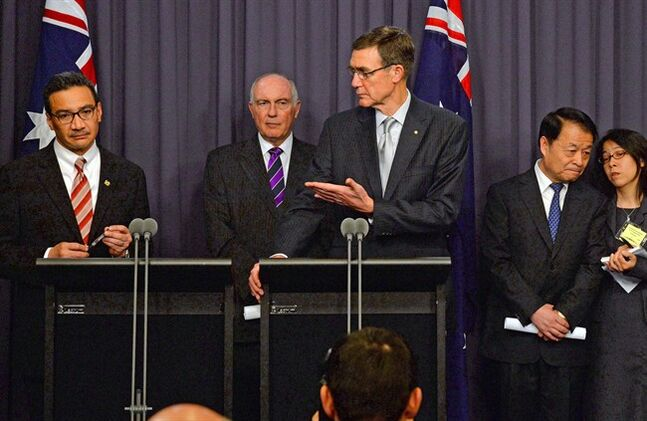 Australia's Transport Minister Warren Truss, second from left, Malaysia's acting Transport Minister Hishammuddin Hussein, left, and China's Transport Minister Yang Chuantang, second from right, attend a press conference for the nearly two-month-old hunt for the missing Malaysian jet with search coordinator Angus Houston, center, in Canberra, Australia, Monday, May 5, 2014. Senior officials from Malaysia, Australia and China are meeting in the Australian capital to hash out the details of the next steps in the search for Malaysia Airlines Flight 370, which will center around an expanded patch of seafloor in a remote area of the Indian Ocean off Western Australia. (AP Photo/AAP Image, Alan Porritt) NO ARCHIVING, NO SALES, AUSTRALIA OUT, NEW ZEALAND OUT, PAPUA NEW GUINEA OUT, SOUTH PACIFIC OUT