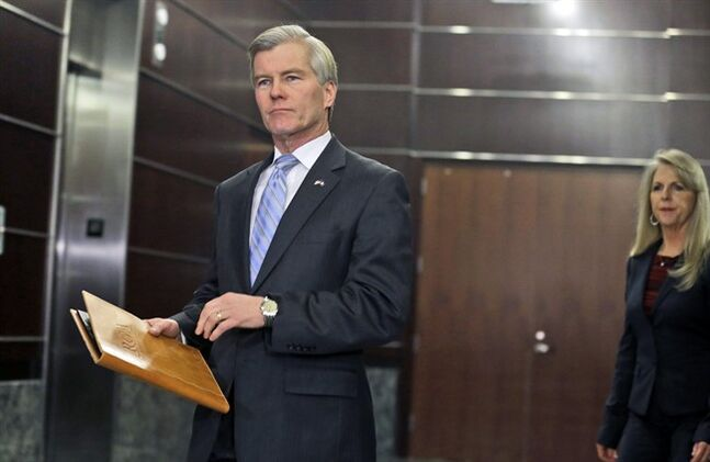 Former Virginia Gov. Bob McDonnell arrives to make a statement followed by his wife, Maureen, in Richmond, Va., Tuesday, Jan. 21, 2014. McDonnell and his wife were indicted Tuesday on corruption charges after a monthslong federal investigation into gifts the Republican received from a political donor. (AP Photo/Steve Helber)
