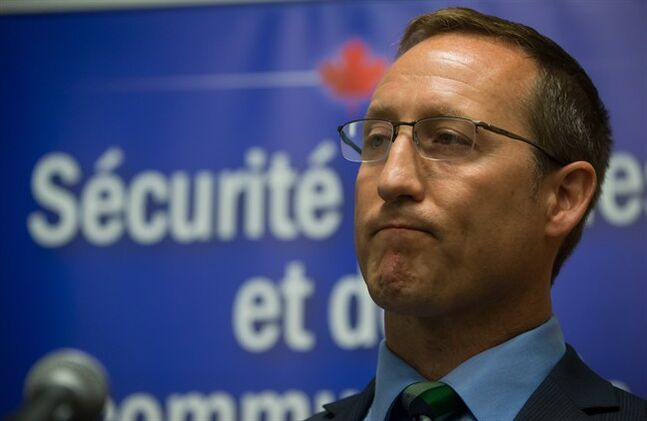 Justice Minister Peter Mackay pauses during a media availability before a roundtable discussion on justice in Vancouver, B.C., on Tuesday August 19, 2014. THE CANADIAN PRESS/Darryl Dyck