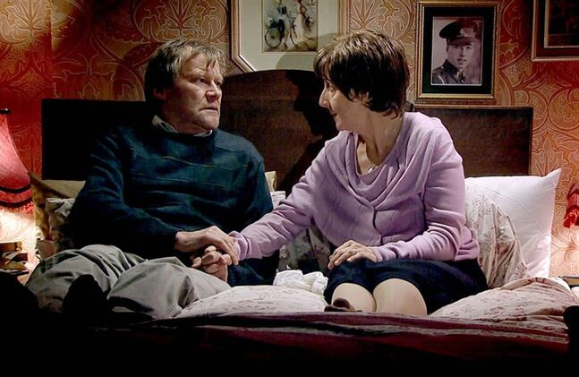 In this photo provided by ITV plc, on Tuesday, Jan. 21, 2014, television characters Roy and Hayley Cropper, played by David Neilson and Julie Hesmondhalgh, in a scene from Coronation Street. THE CANADIAN PRESS/AP, ITV plc