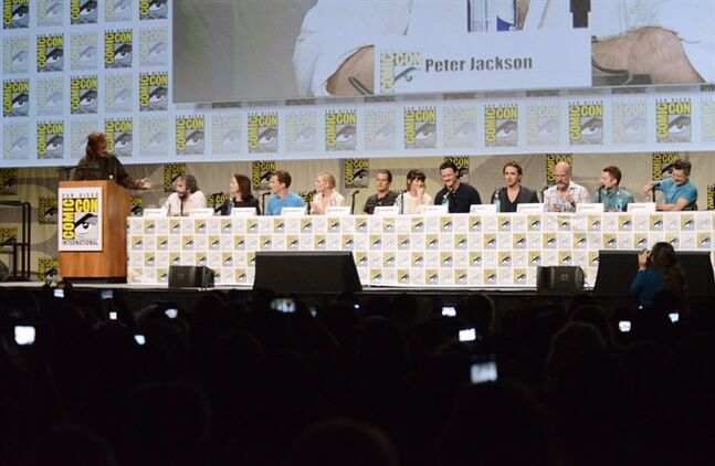 Stephen Colbert, from left, director Peter Jackson, writer Philippa Boyens, Benedict Cumberbatch, Cate Blanchett, Orlando Bloom, Evangeline Lilly, Luke Evans, Lee Pace, Graham McTavish, Elijah Wood and Andy Serkis attend the Warner Bros. Pictures panel for