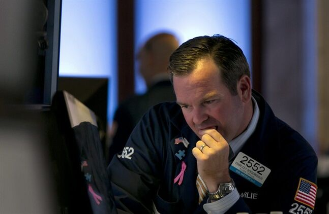 Specialist Charles Boeddinghaus works at his post on the floor of the New York Stock Exchange Thursday, Aug. 7, 2014. U.S. stocks are opening slightly higher after Europe's main two central banks decided to keep interest rates on hold. (AP Photo/Richard Drew)