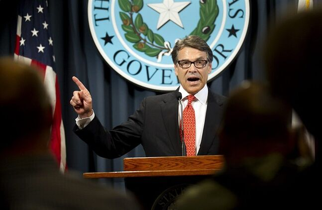 Gov. Rick Perry makes a statement in Austin, Texas on Saturday, Aug. 16, 2014 concerning the indictment on charges of coercion of a public servant and abuse of his official capacity. Perry is the first Texas governor since 1917 to be indicted. (AP Photo/Austin American-Statesman, Laura Skelding)