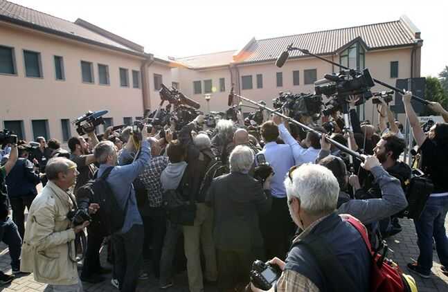 Reporters gather outside the