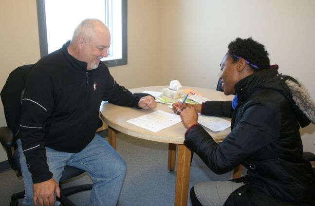 Natasha Henry (right) meets with Brett Turner, a volunteer with the Community Volunteer Income Tax Program at the Seventh Street Health Access Centre. Students, seniors and other low-income individuals may be eligible for free assistance through the program.