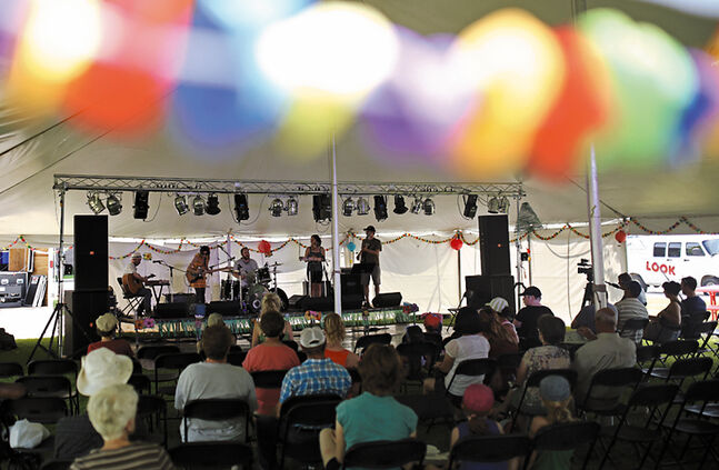 Winnipeg based folk-western musicians Nathan perform during the second day of the 2014 Brandon Multicultural Summer Festival at Princess Park on Saturday afternoon.