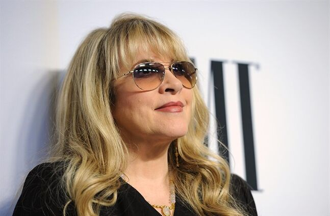 FILE - This May 13, 2014 file photo shows Stevie Nicks, winner of the BMI Icon Award, at the 62nd Annual BMI Pop Awards in Beverly Hills, Calif. Nicks has come on board The Voice this season as Adam Levine's adviser to his team. She and Adam have been filming in Burbank, Calif., with his team of 12, working with each of his artists as they assign songs and rehearse with them, preparing for the Battle Rounds. Season 7 of The Voice started production last month and will premiere on September 22 on NBC. (Photo by Chris Pizzello/Invision/AP, File)