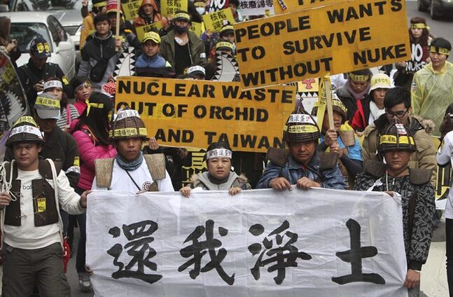 Protesters march during an anti-nuclear demonstration, in Taipei, Taiwan, on March 11, 2012. The banner in foreground reads: