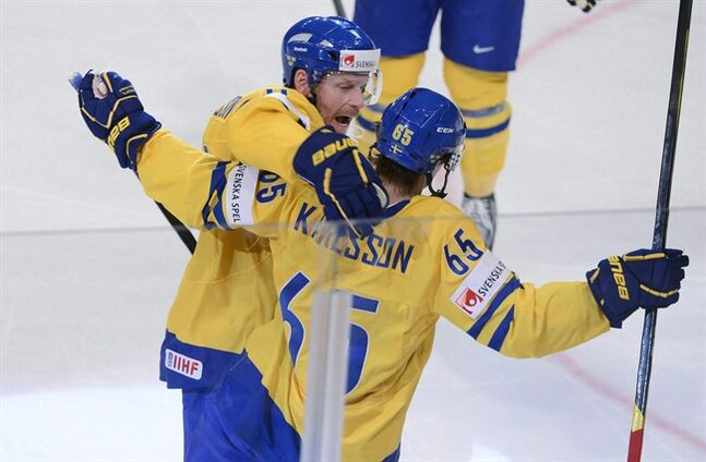 Sweden's Erik Karlsson, right, and Daniel Alfredsson celebrate the 1-0 goal during their Group S IIHF Ice Hockey World Championship match between Russia and Sweden at the Ericsson Globe Arena in Stockholm, Sweden, Friday May 11, 2012. THE CANADIAN PRESS/AP,Claudio Bresciani /SCANPIX SWEDEN OUT