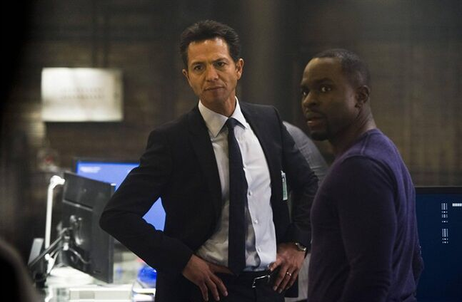 This image released by Fox shows Benjamin Bratt, left, and Gbenga Akinnagbe in a scene from
