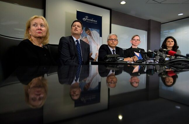 From left to right, Providence Health President and CEO Dianne Doyle, David Byres, Providence vice president of Acute Clinical Programs, lawyer Joseph Arvay, representing Providence, lawyer Adrienne Smith, of the Pivot Legal Society, and lawyer Angela Juba, representing Pivot, attend a news conference after the B.C. Supreme Court re-established access to diacetylmorphine (heroin) assisted treatment following a 2013 change by the federal government classifying it as a restricted substance, in Vancouver, B.C., on Thursday May 29, 2014. THE CANADIAN PRESS/Darryl Dyck