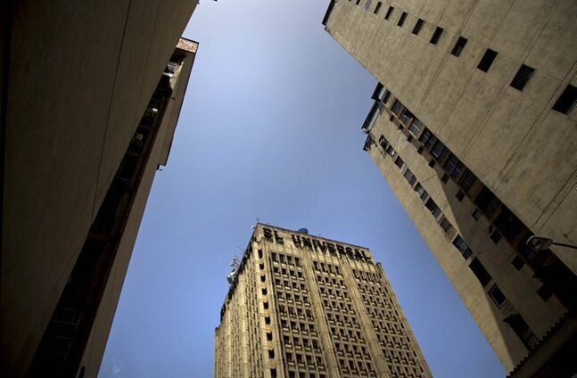 A skyward view of the El Universal newspaper headquarters, in downtown Caracas, Venezuela, Friday, July 4, 2014. El Universal, one of Venezuela's most prestigious newspapers has been sold, Editor in Chief Elides Rojas confirmed. Details of the sale of Caracas-based El Universal to a group of Spanish investors were still emerging Friday. (AP Photo/Ramon Espinosa)