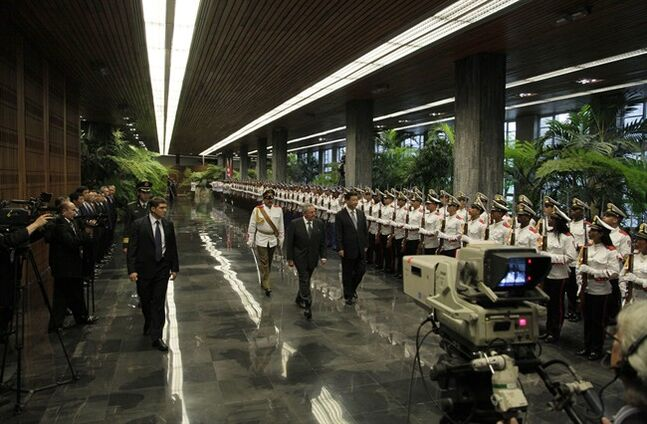 Cuba's President Raul Castro, center, and China's President Xi Jinping review the troops during a welcoming ceremony at Revolution Palace in Havana, Cuba, Tuesday, July 22, 2014. Xi Jinping is in an official state visit to Cuba. (AP Photo/Cubadebate, Ismael Francisco)