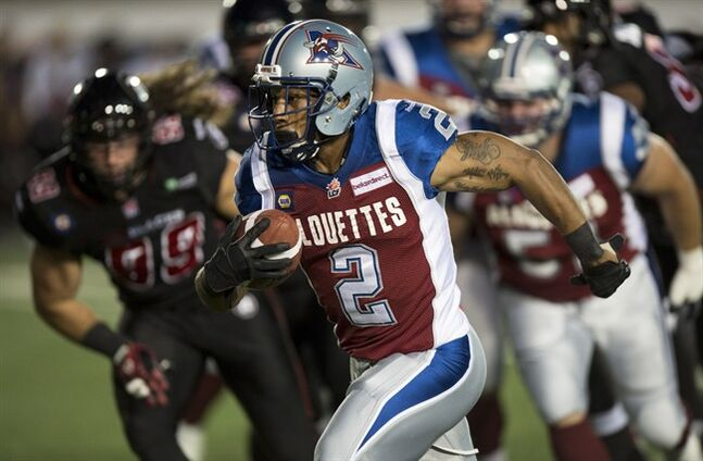 Montreal Alouettes running back Brandon Whitaker runs with the ball asthey face the Ottawa Redblacks during first quarter CFL football action Friday, August 29, 2014 in Montreal. THE CANADIAN PRESS/Paul Chiasson