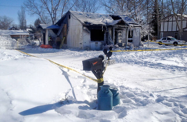 Police tape surrounds the home of Martha and Wally Kroeker in Boissevain. Martha lost her life in a fire at the home early Tuesday. Her husband Wally escaped, but reportedly suffered serious burns and was taken to hospital. Officials said the cause of the blaze has yet to be determined.