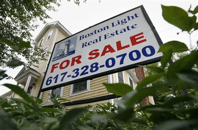 FILE - This July 10, 2014 file photo shows a home for sale in Quincy, Mass. On Thursday, Aug. 21, 2014, Freddie Mac is scheduled to report on average U.S. mortgage rates for the week. (AP Photo/Michael Dwyer, File)