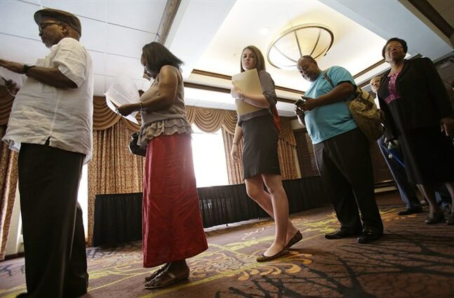 In this Thursday, June 12, 2014 photo, people wait in line for the Cleveland Career Fair in Independence, Ohio. The Labor Department releases employment data for June on Thursday, July 3, 2014. (AP Photo/Tony Dejak)