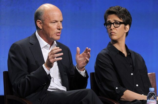 FILE - This Aug. 2, 2011 file photo shows MSNBC President Phil Griffin, left, answering a question as Rachel Maddow, host of