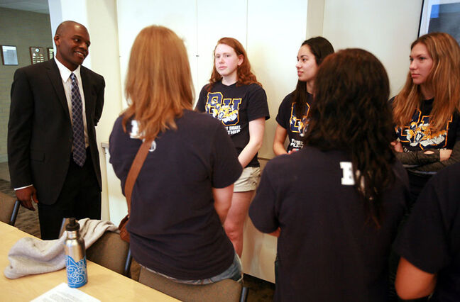 New Brandon University Bobcats women's basketball coach Novell Thomas chats with his returning players.