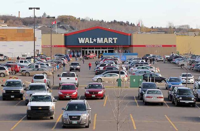 Shoppers make their way to and from Walmart in the Corral Centre on Sunday.