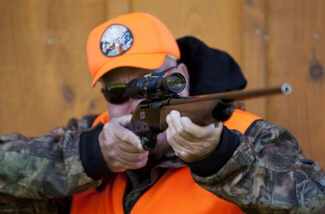 A rifle owner checks the sight of his rifle at a hunting camp property in rural Ontario west of Ottawa on Wednesday Sept. 15, 2010. The Harper government says it will introduce legislation this fall to ease restrictions on transporting firearms while making firearms-safety courses mandatory for first-time gun owners. THE CANADIAN PRESS/Sean Kilpatrick